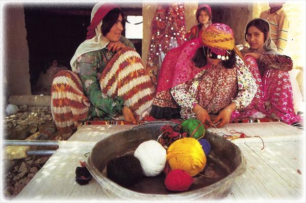 Women hand crafting fine rugs